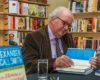 Cheltenham Gloucestershire.Cheltenham Literature Festival.... Alexander McCall Smith at a book  signing for his new novel House of the Unexpected Sisters.